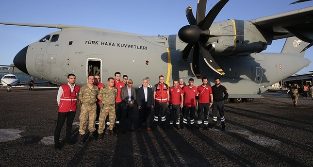 Turkish medical staff pose in front of the military aircraft ahead of their departure to Somalia on Tuesday, Jan. 21, 2020. AA Photo