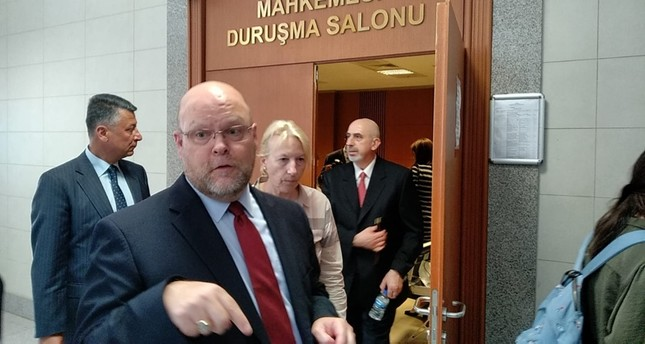 US Charge d'Affaires in Ankara Jeffrey Hovenier (L) speaks to reporters as US Istanbul Consulate Mete Cantürk, the suspect in trial over alleged links to FETÖ, leaves the courtroom in Istanbul's Çağlayan Courthouse. (DHA Photo)