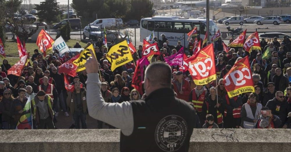 CGT union leader Olivier Mateu gives a speech to union members at a petrochemical factory where workers have been striking, Martigues, Dec. 14, 2019. (AP Photo/Daniel Cole)