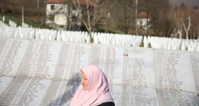 A woman walks past the Memorial plaque with the names of people killed in the Srebrenica massacre at the Memorial center Potocari near Srebrenica, Bosnia and Herzegovina, Nov. 22, 2017. Reuters Photo