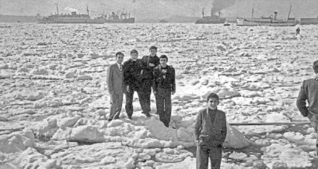 A group of young men standing on icy Bosporus on the Feb. 1954.