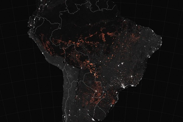 This handout NASA Earth Observatory map shows active fire detections in South America as observed by Terra and Aqua MODIS between August 15-22. (AFP Photo)