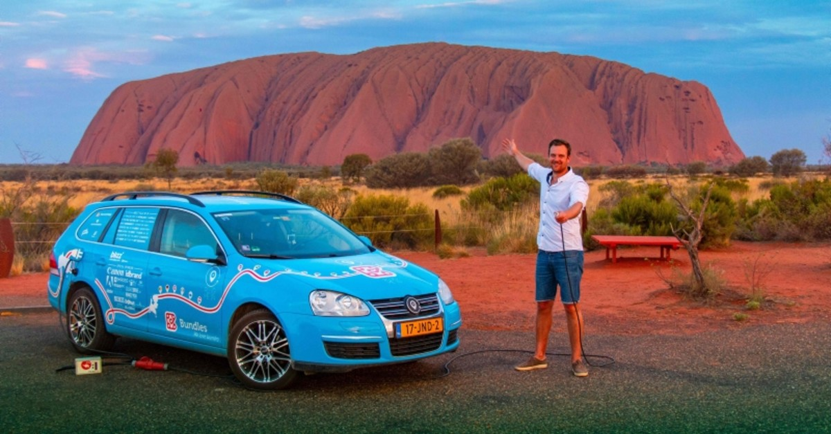 In this handout photo taken on December 31, 2018 and released on April 7, 2019 from Dutch driver Wiebe Wakker (C-R) shows him at Uluru in the Northern Territory (AFP Photo)