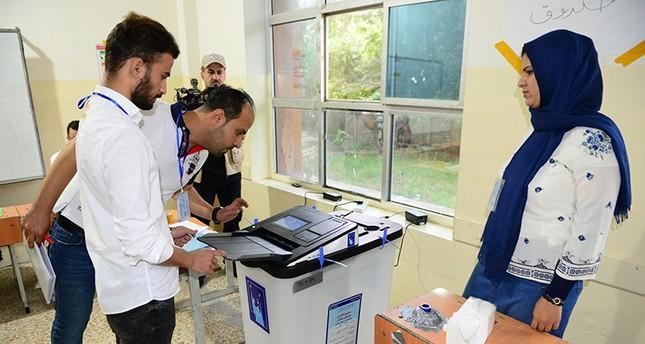 الناخبون العراقيون يبدؤون التصويت وعملية الاقتراع تسير بسلاسة
