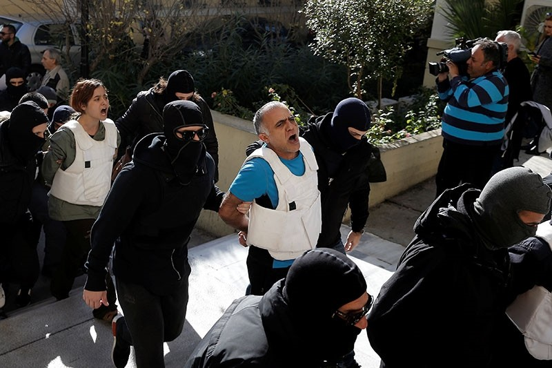 In this Wednesday, Nov. 29, 2017 file photo, DHKP-C terrorist u015eadi Naci u00d6zpolat is escorted by anti-terror police while arriving at a court in Athens. A Greek court has rejected a Turkish extradition request for u00d6zpolat, on March 6, 2018. (Reuters Ph