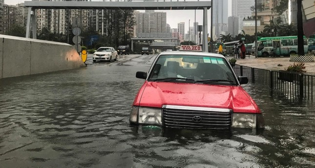 A taxi is abandoned in floodwaters during Super Typhoon Mangkhut in Hong Kong on September 16, 2018. (AFP Photo)
