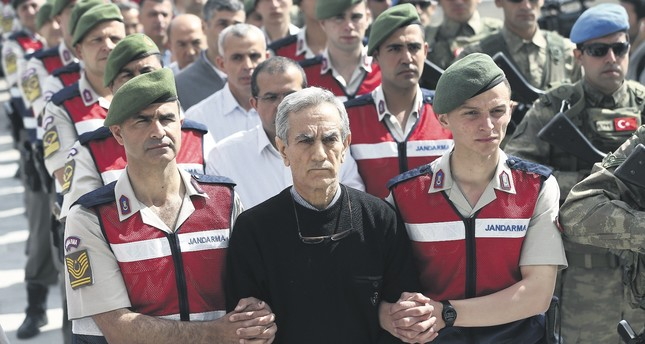 Akın Öztürk, the former general accused of commanding the putsch attempt and other defendants accompanied by troops at the first hearing of a trial in the capital Ankara in May 2017.