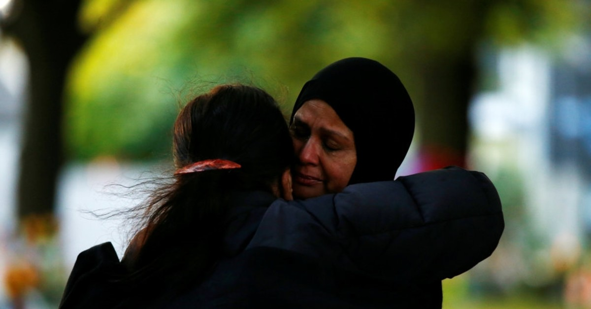Women comfort each other outside of Al Noor Mosque in Christchurch, March 21, 2019.
