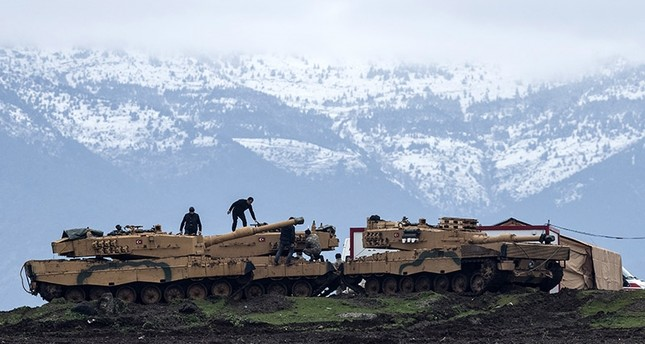Turkish soldiers train with their tanks and armored vehicles near Syrian-Turkish border, at Hatay, Turkey, 24 January 2018. (EPA Photo)