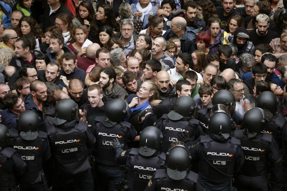 Spanish riot police form a security cordon around the Ramon Llull school in Barcelona, Catalonia, Spain, Oct. 1.