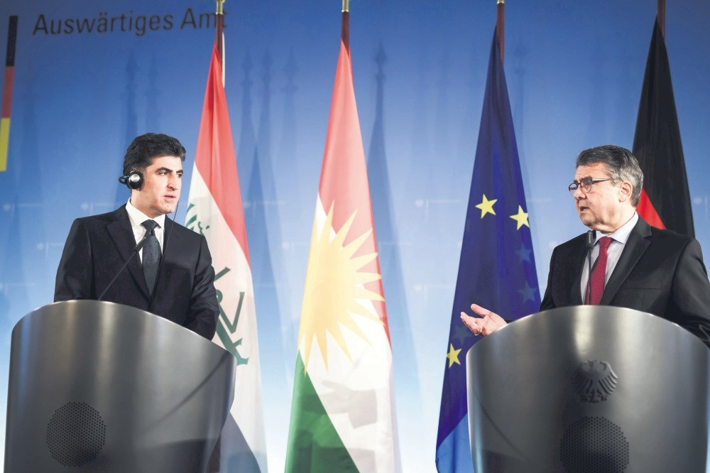 Kurdistan Regional Government Prime Minister Nechirvan Barzani and German Foreign Minister Sigmar Gabriel (R) at a joint press conference prior to their meeting in Berlin, Germany, Dec. 18.