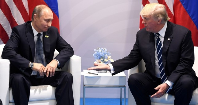 In this file photo taken on July 07, 2017 US President Donald Trump and Russia's President Vladimir Putin shake hands during a meeting on the sidelines of the G20 Summit in Hamburg, Germany. AFP Photo