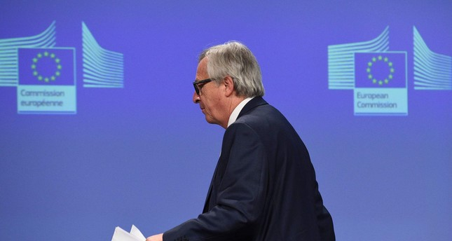 European Commission chief Jean-Claude Juncker leaves after a joint press conference  at the EU Headquarters in Brussels on June 24, 2016. (AFP Photo)