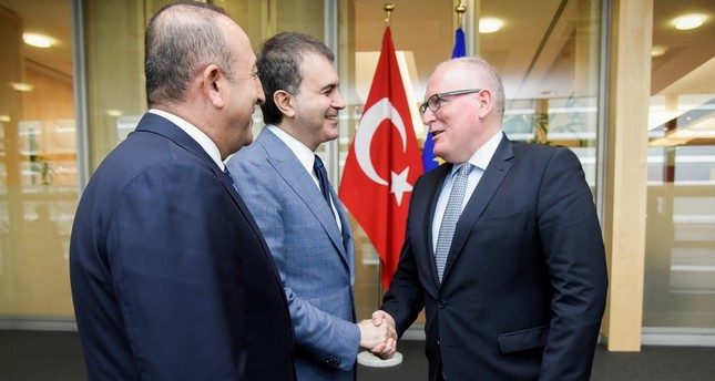 EU Minister Çelik (C) and Foreign Minister Çavuşoğlu (L) were in Brussels on June 30 to attend meetings with EU authorities.