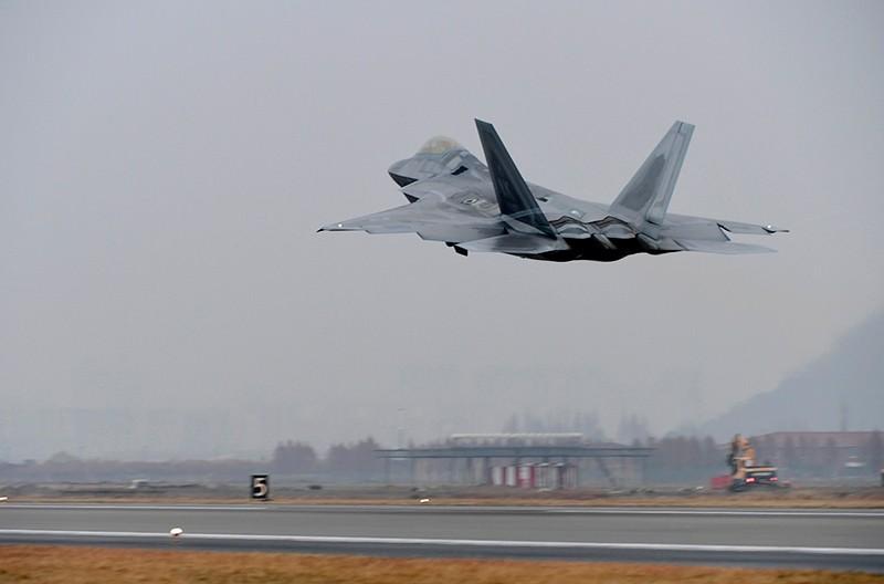 A U.S. Air Force F-22 Raptor takes off from a South Korean air base in Gwangju, South Korea, Dec. 4, 2017. (Yonhap via AP)