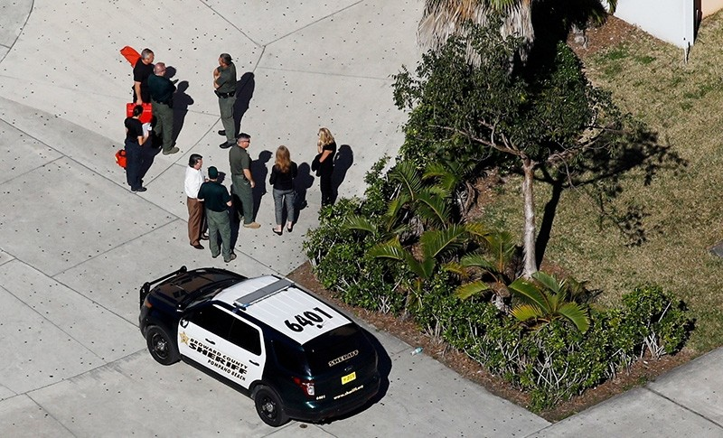 Crime scene investigators are seen at Marjory Stoneman Douglas High School following a mass shooting in Parkland, Florida (Reuters File Photo)