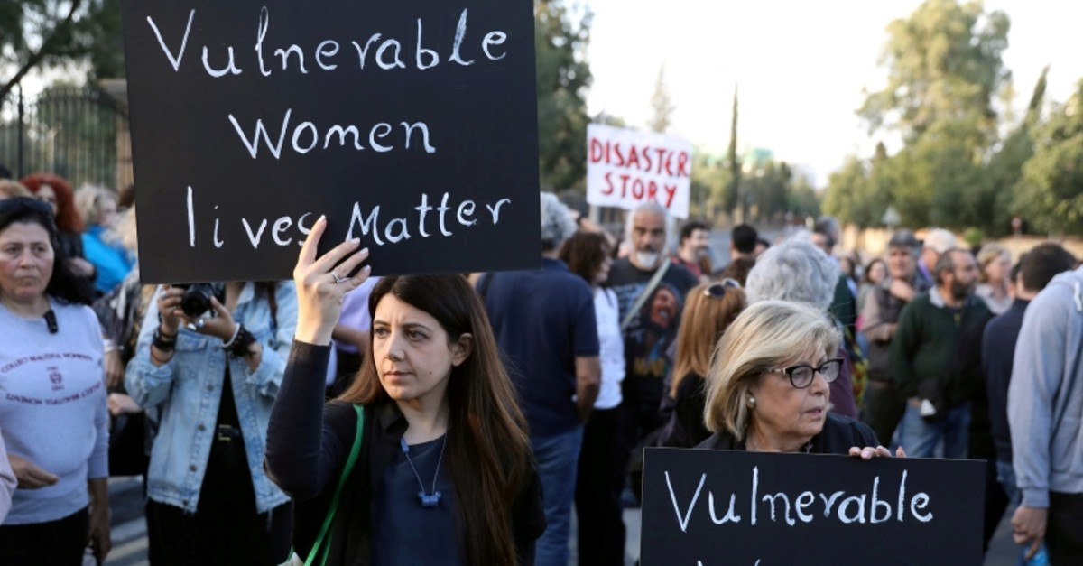 People attend hold placards during a public gathering in memory of the victims of a suspected serial killer, outside the Presidential Palace in Nicosia, Greek Cyprus, May 3, 2019. (Reuters Photo)