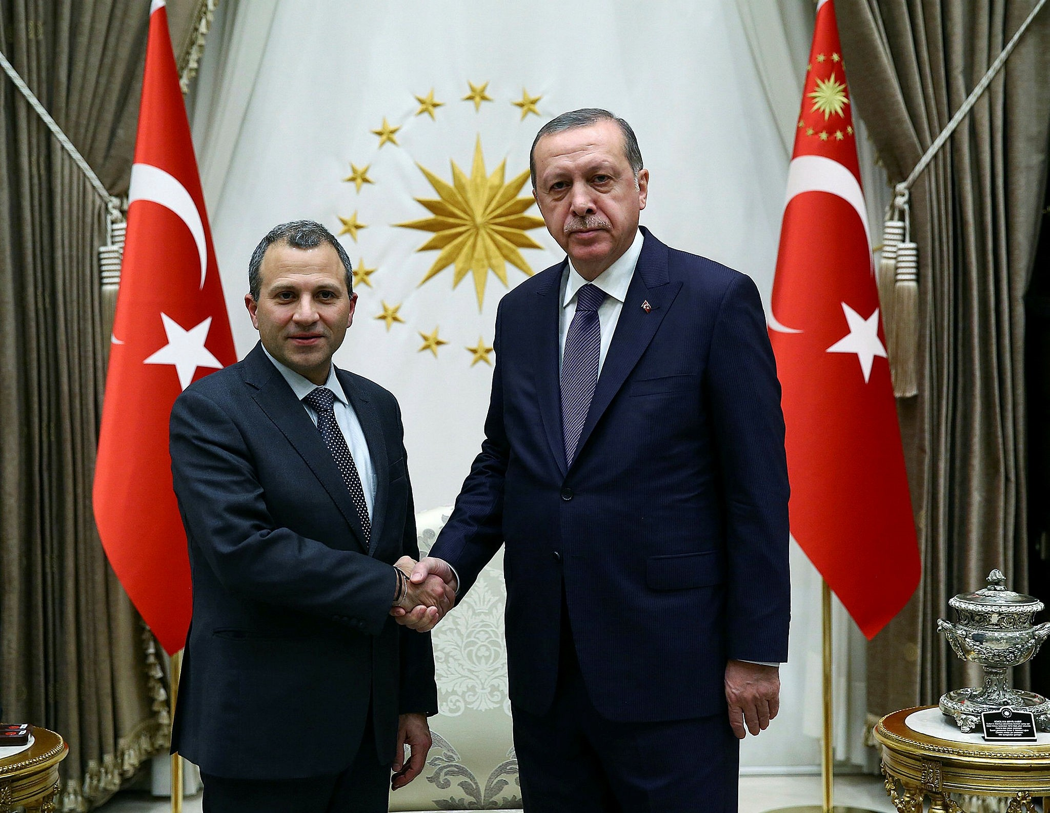 Bassil (L) and Erdou011fan shaking hands (Photo by Turkish Presidency)