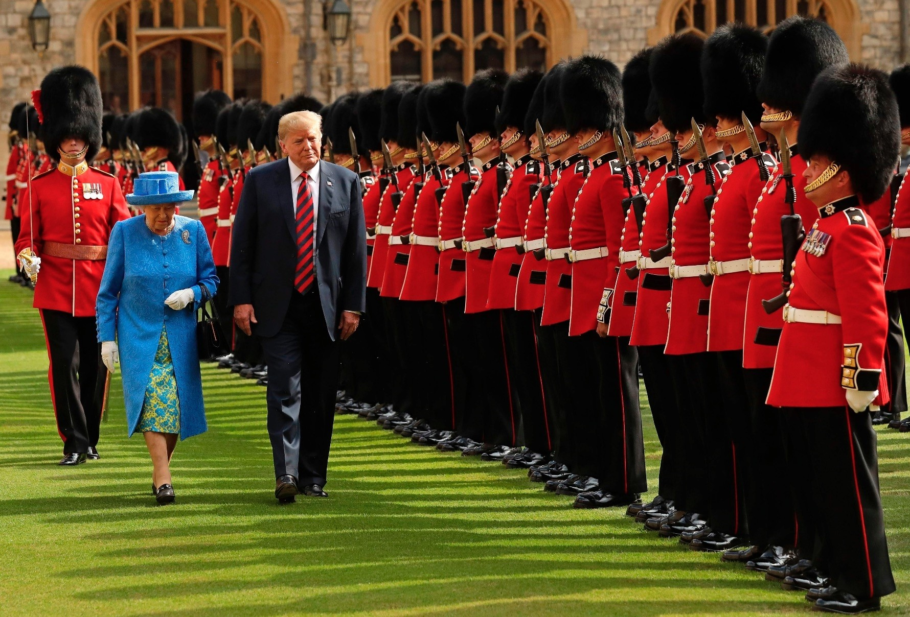 Britain's Queen Elizabeth II (L) and U.S. President Donald Trump inspect the guard of honor formed by the Coldstream Guards during a welcome ceremony at Windsor Castle, west of London, on the second day of Trump's U.K. visit, July 13.