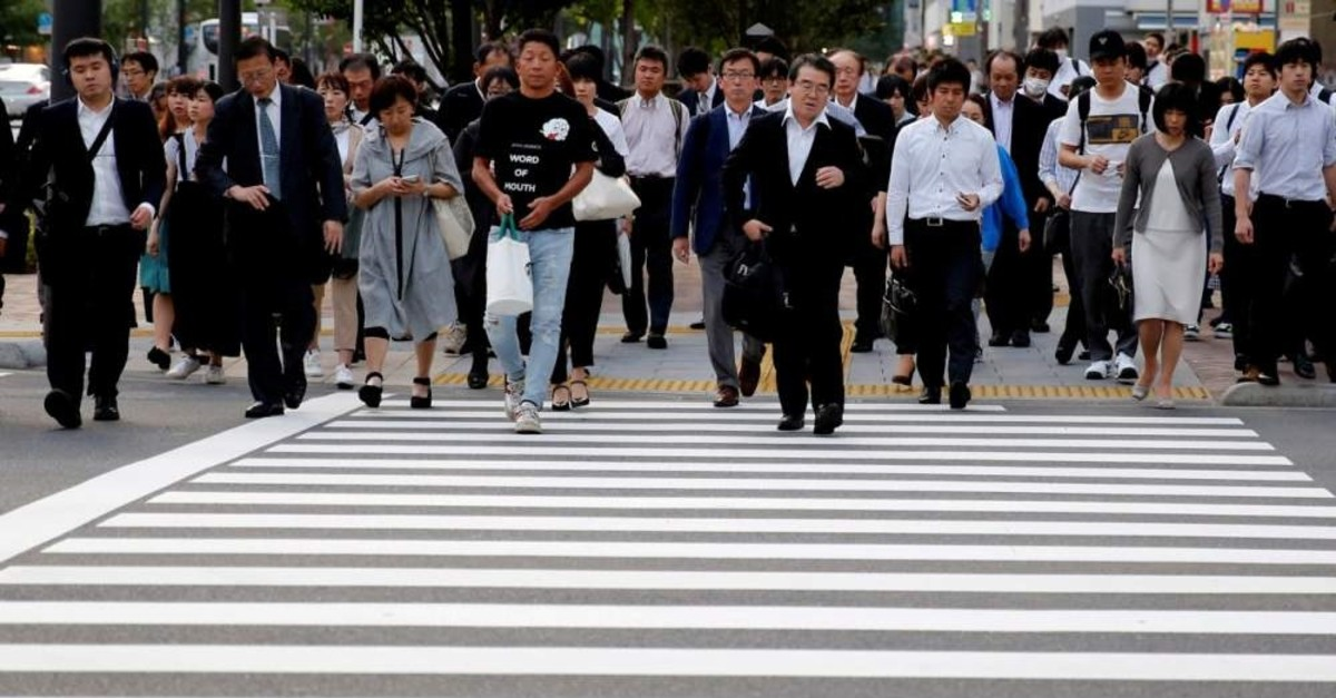 Pedestrians make their way in a business district in Tokyo, Japan, May 16, 2018. (Reuters Photo)