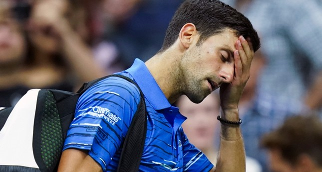 Novak Djokovic, of Serbia, walks off the court as he retires during his match against Stan Wawrinka, of Switzerland, during the fourth round of the U.S. Open tennis championships, Sunday, Sept. 1, 2019, in New York. AP Photo