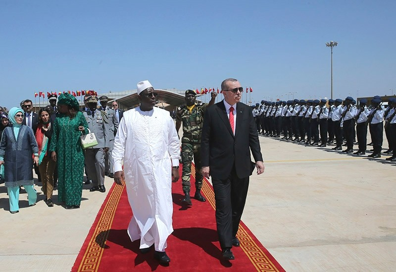 President Recep Tayyip Erdogan, right, and Senegalese President Macky Sall review a military honour guard before leaving for neighbouring Mali, in Dakar, Senegal. (AP Photo)