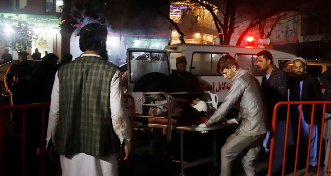 Afghan health workers carry an injured person outside the emergency hospital after a suicide attack targeted a wedding hall, in Kabul, Afghanistan, Nov. 20, 2018. EPA Photo