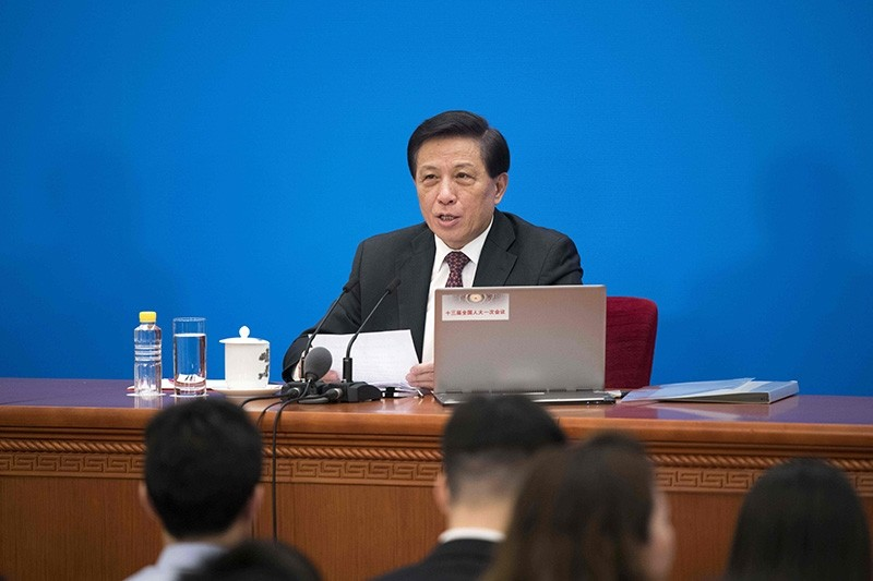 Zhang Yesui, the spokesperson of China's National People's Congress, holds a press conference at the Great Hall of the People in Beijing on March 4, 2018 (AFP Photo)