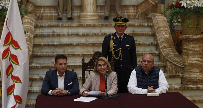 Bolivia's interim President Jeanine Anez (C) speaks during a press conference at the presidential palace, La Paz, Nov. 28, 2019. (AP Photo)