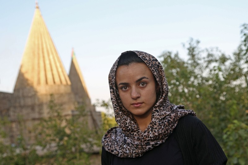 Yazidi woman Ashwaq Haji, allegedly used by Daesh as a sex slave, visits the Lalish temple in tribute to the terrorists' victims from her village of Kocho near Sinjar, in Lalish, northern Iraq, on August 15, 2018. (AFP Photo)