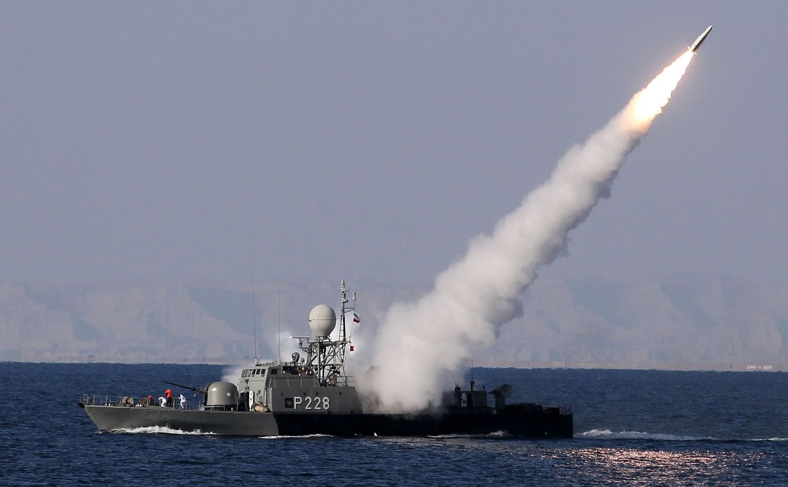 An Iranian navy warship test fires a new long range missile during the Iranian navy military exercise on the Sea of Oman, near the Strait of Hormuz in southern Iran.