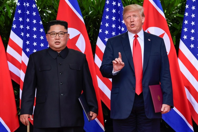In this June 12, 2018, file photo, U.S. President Donald Trump makes a statement before saying goodbye to North Korea leader Kim Jong Un after their meetings at the Capella resort on Sentosa Island in Singapore. (AP Photo)