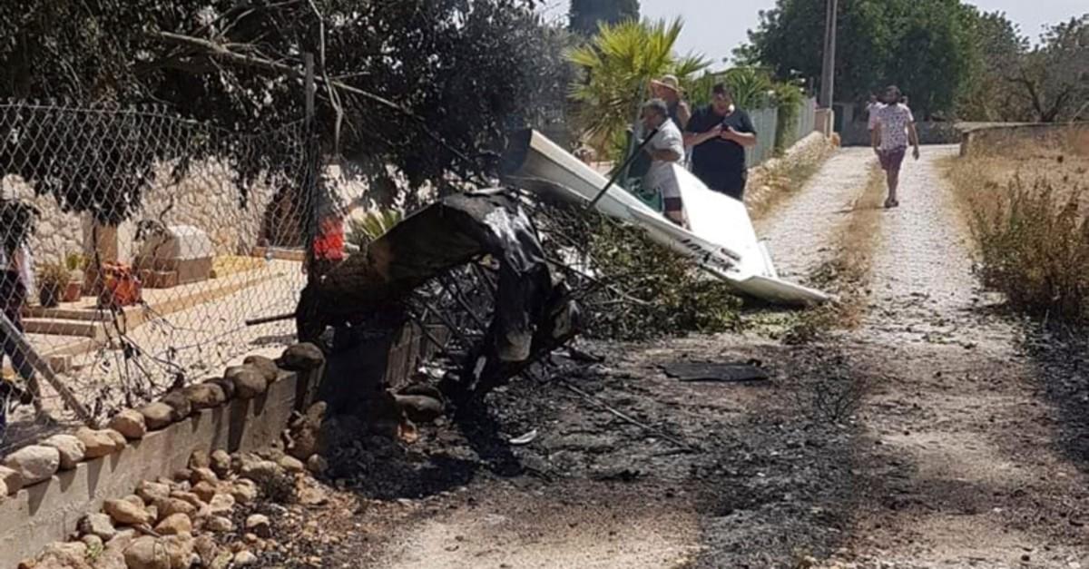 This photo provided by Incendios f.Baleares shows wreckage on a path near Inca in Palma de Mallorca, Spain, Sunday Aug. 25, 2019. (AP Photo)