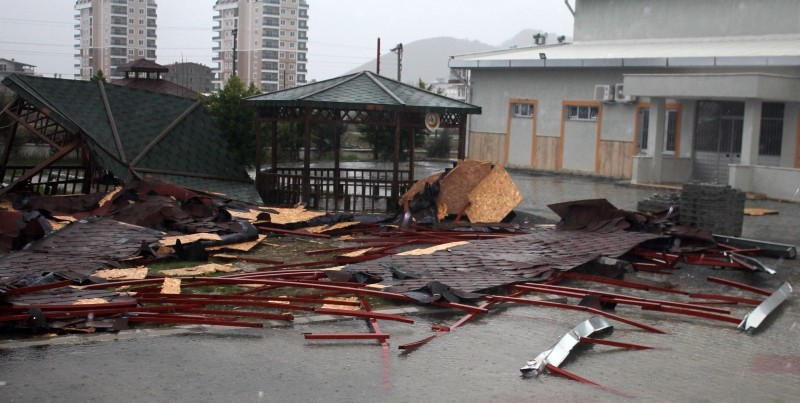After severe winds and heavy rain, the roof of a 10-story building flew off and landed on school grounds in the Gaziosmanpau015fa district of Antalya last week. (DHA Photo)