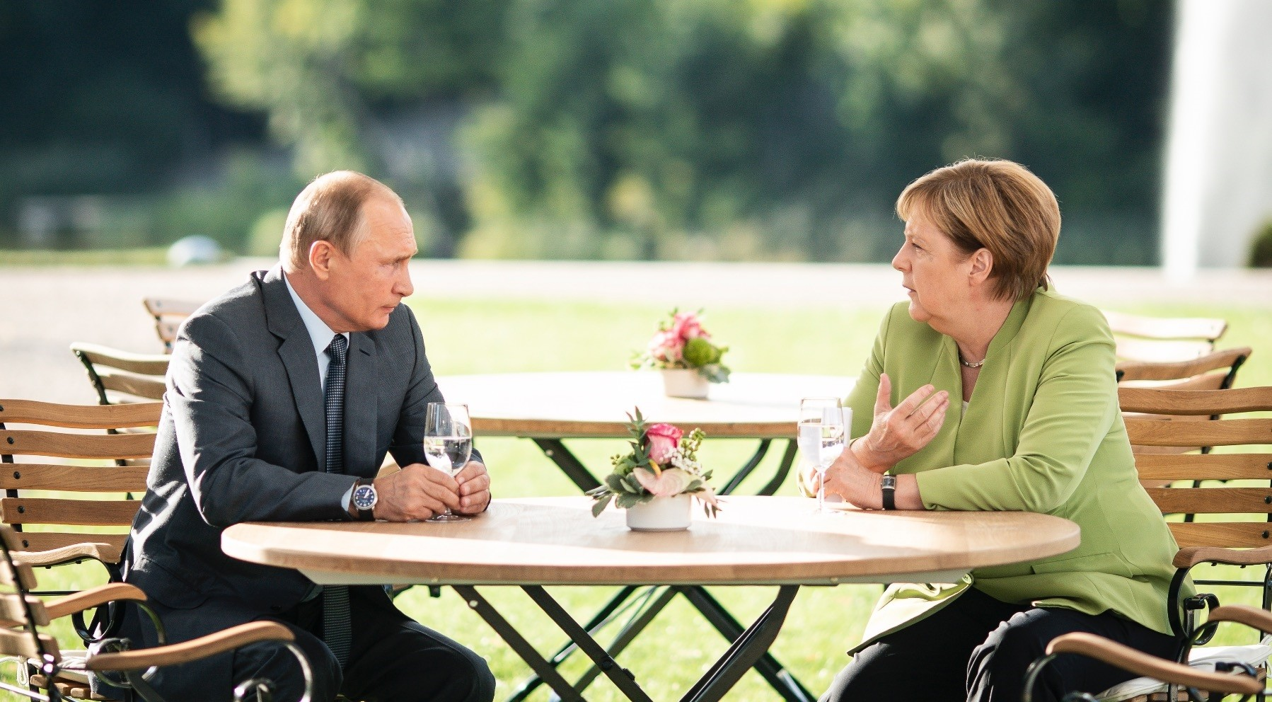 Russian President Vladimir Putin (L) and German Chancellor Angela Merkel (R) hold talks at the German governmentu2019s guest house Meseberg Palace, Gransee, Aug. 18.