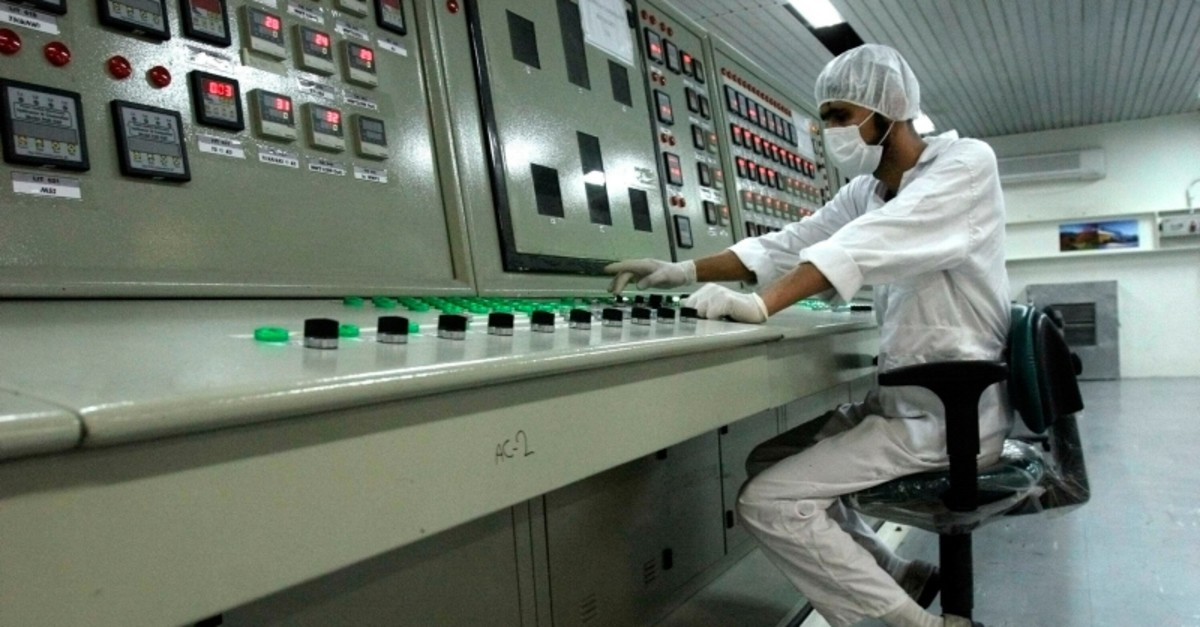In this Feb. 3, 2007 file photo, an Iranian technician works at the Uranium Conversion Facility just outside the city of Isfahan, Iran, 255 miles (410 kilometers) south of the capital Tehran. (AP Photo)