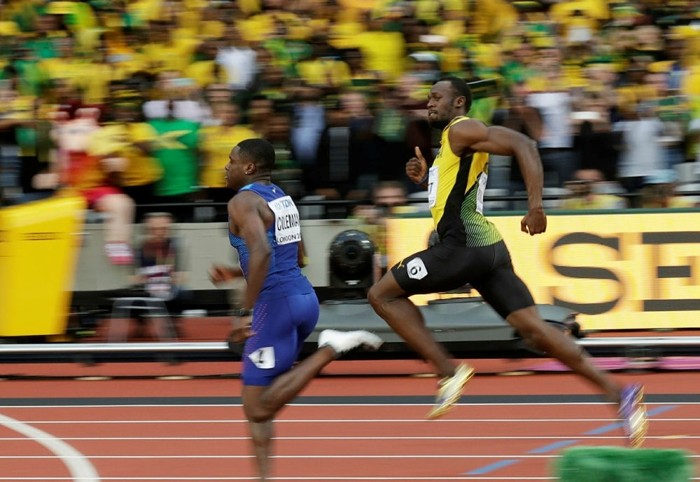 Jamaica's Usain Bolt looks to United States' Christian Coleman, left, in a men's 100m semifinal during the World Athletics Championships in London Saturday, Aug. 5, 2017. (AP Photo)