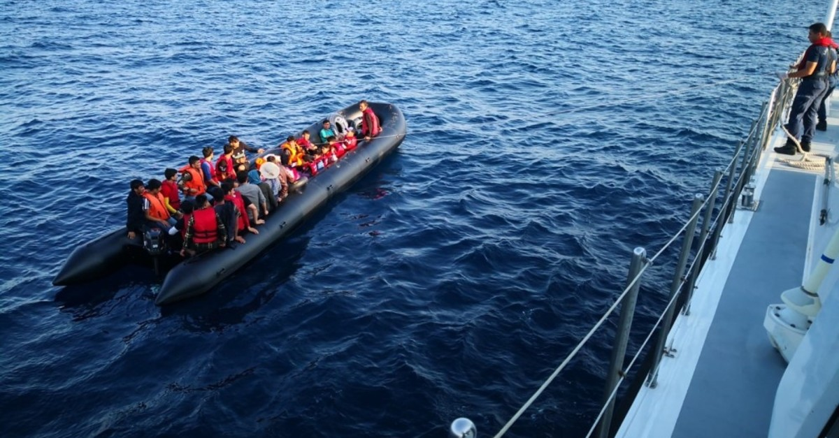 Turkish Coast Guard officers approach illegal migrants heading to Greece from the Enez coast of Edirne province, July 31, 2019.