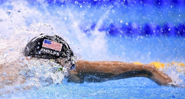 Phelps competes in the Men's 4x100m Freestyle Relay Final during the swimming event at the Rio 2016 Olympic Games at the Olympic Aquatics Stadium in Rio de Janeiro on August 7, 2016. (AFP PHOTO)