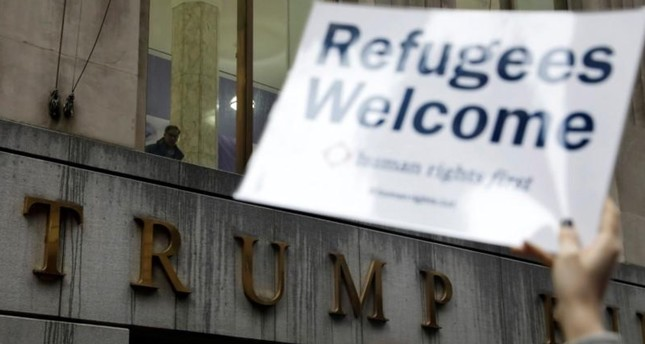 Protesters gather outside the Trump Building at 40 Wall St. to take action against America's refugee ban in New York City, U.S., March 28, 2017. (Reuters Photo)