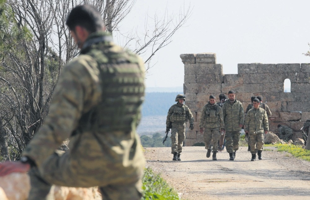 Turkish soldiers prepare during an offensive as part of Operation Olive Branch against the YPG, Der Mismis, Afrin, March 13.