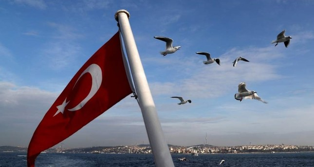 A Turkish flag flies on a passenger ferry with the Bosphorus in the background in Istanbul, Jan. 27, 2020. REUTERS