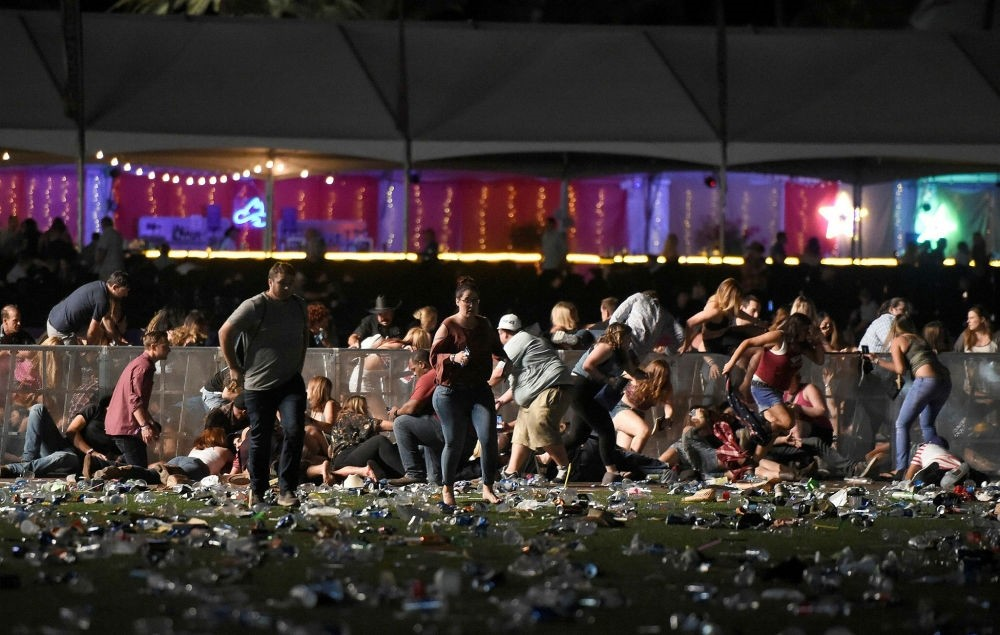 People run from the Route 91 Harvest country music festival after apparent gun fire was heard in Las Vegas, Nevada on Oct. 1.