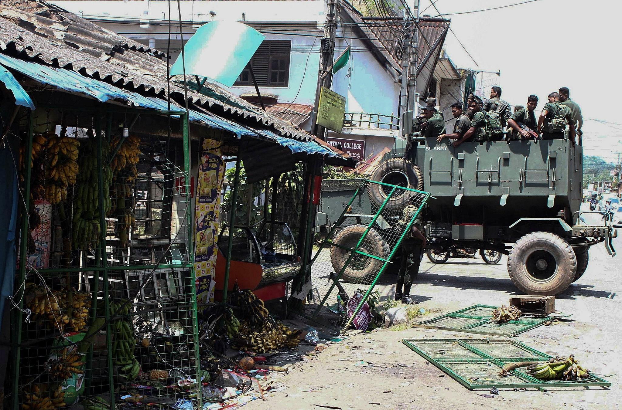 Sri Lankan army patrol the streets of Katugastota, a suburb of Kandy, March 8.