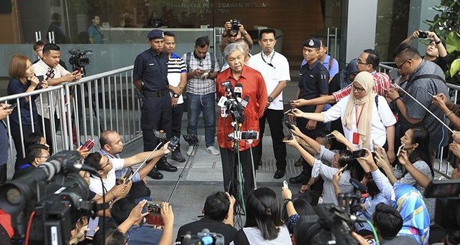 Malaysia's former Deputy Prime Minister Ahmad Zahid Hamidi, center, speaks to media outside Anti-Corruption Agency in Putrajaya, Malaysia Monday, July 2, 2018. (AP Photo)