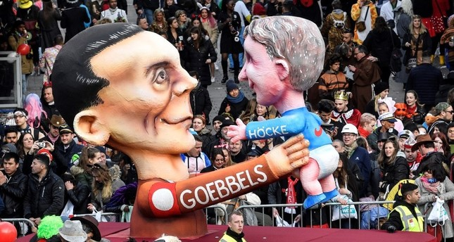 A carnival float depicts Nazi propaganda minister Joseph Goebbels holding right-wing AfD politician Bjoern Hoecke during the traditional carnival parade in Duesseldorf, Germany, March 4, 2019.