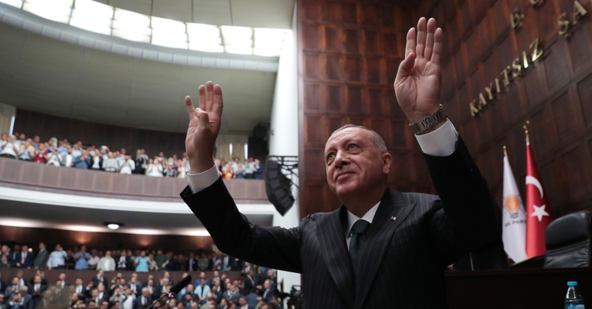President Recep Tayyip Erdou011fan salutes his party members during a party meeting in Ankara, June 25, 2019.