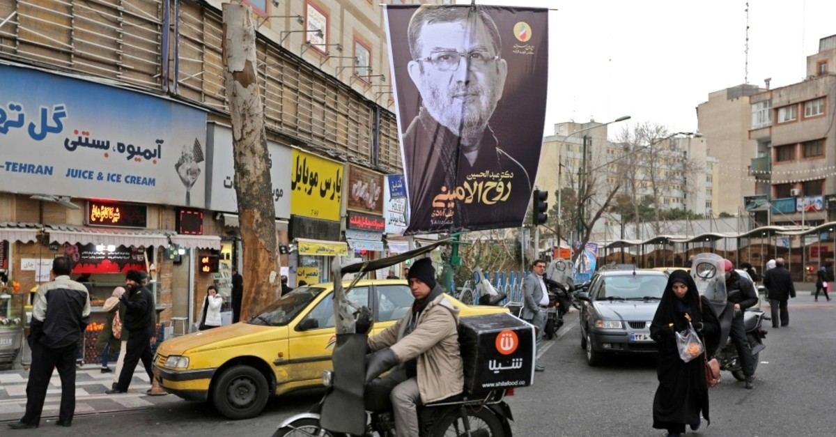 Electoral posters are pictured on the eve of the parliamentary election, Tehran, Feb. 20, 2020. (AFP Photo)
