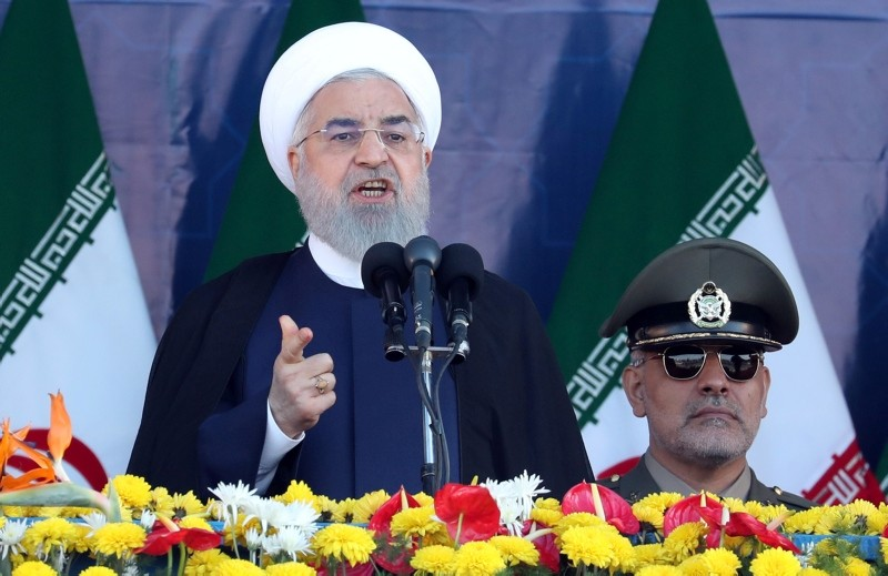 Iranian President Rouhani delivers his speech during the annual military parade, hours before gunmen opened fire killing at least 24 people, and injuring dozens during the parade in Ahvaz, 22 September 2018. (EPA)
