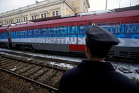 A Serbian train halted at the border with Kosovo and bearing signs reading